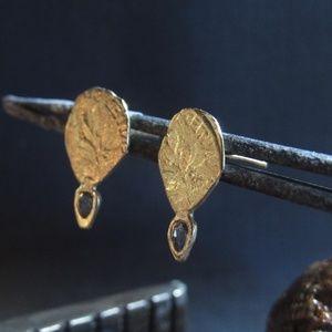 14k gold earrings.